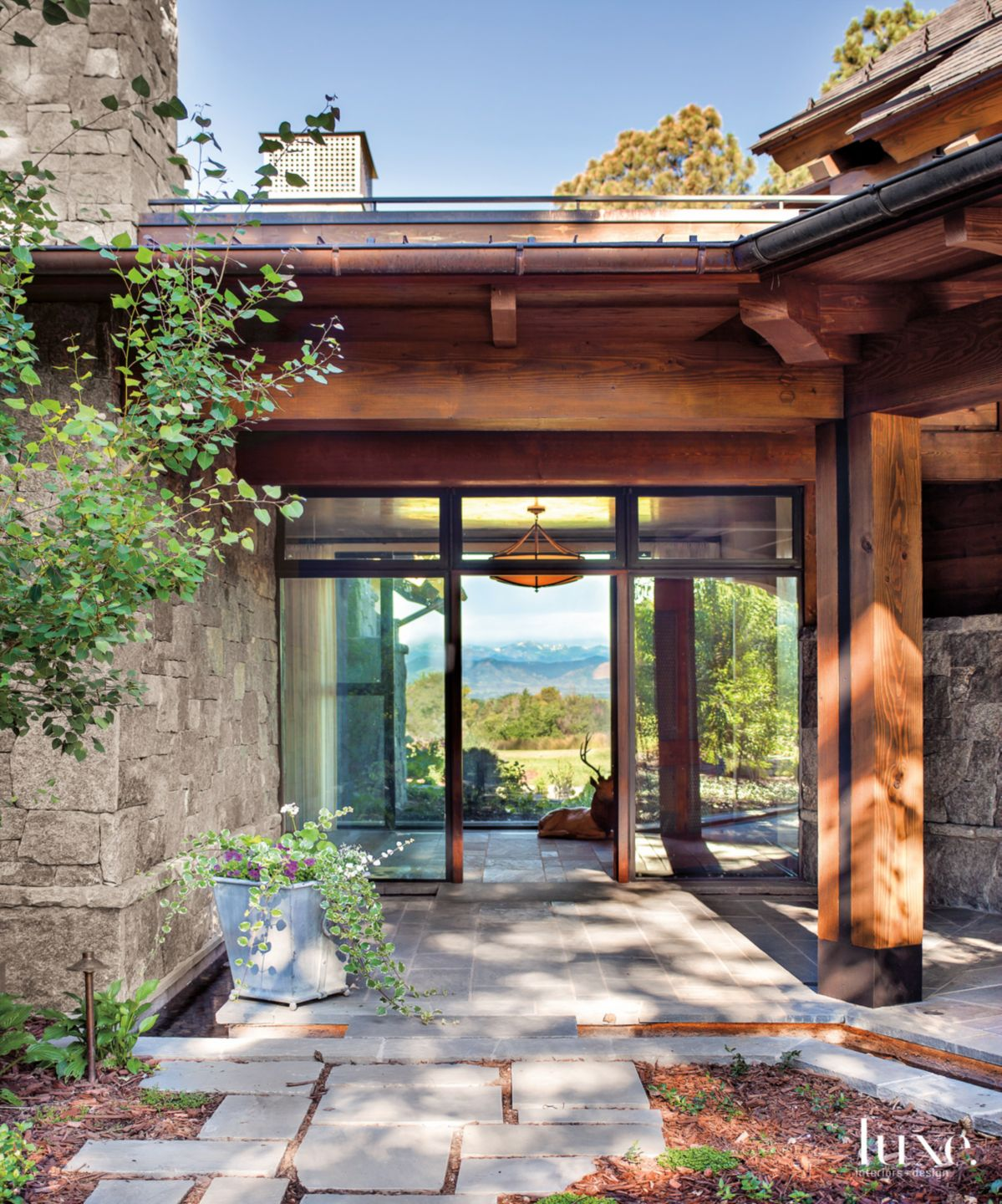 See-Thru Foyer with Mountain Views in A Modern Denver Home