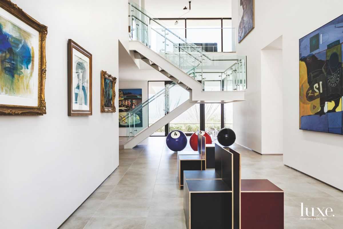 White & Glass Staircase With Art in Tucson