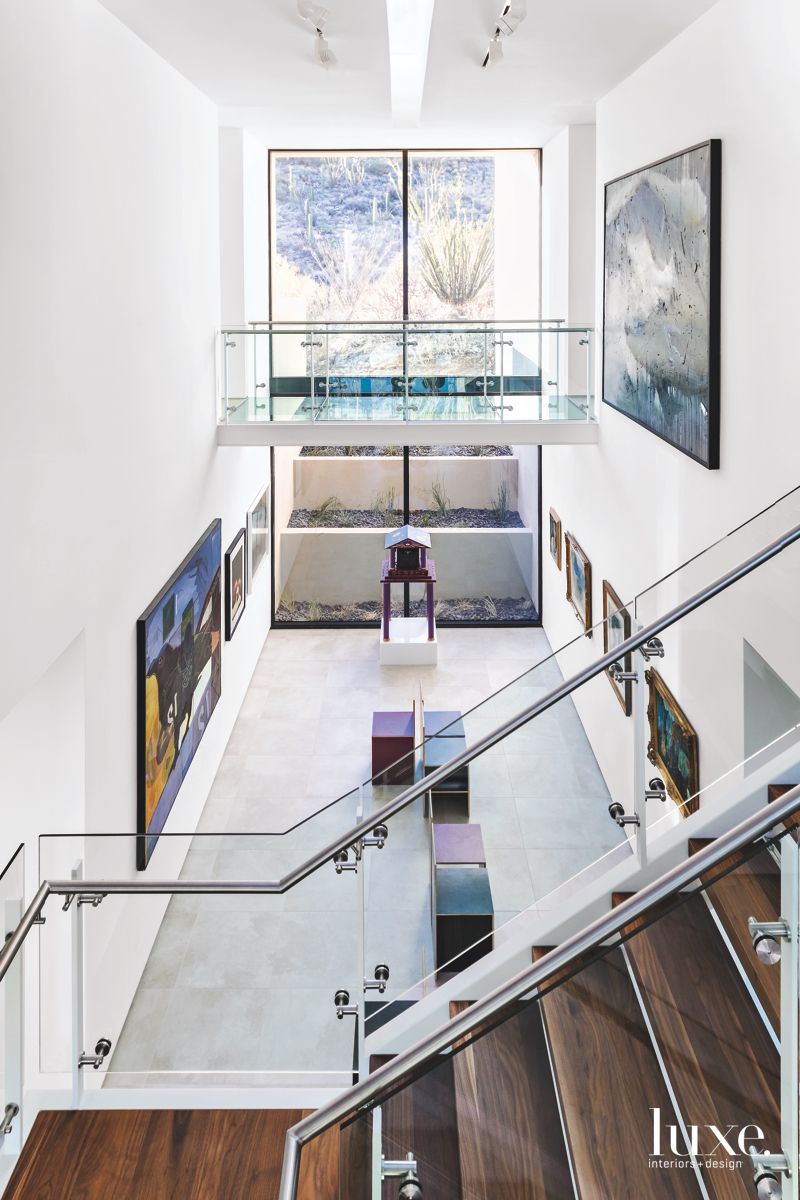 Art-Filled Staircase & Foyer in Contemporary Tucson Home