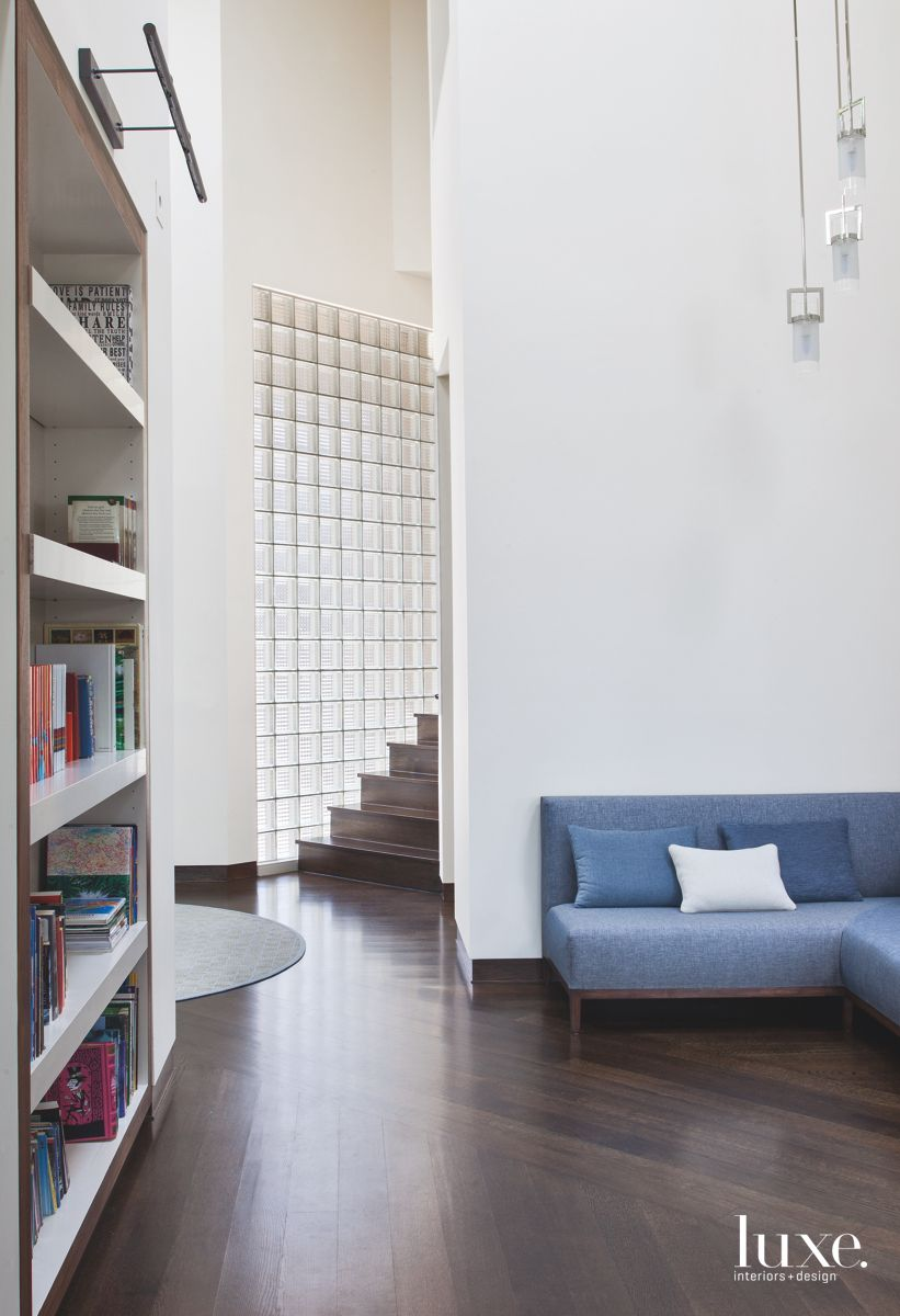 Warm Library Tucked Beside a Staircase in Modernist Denver Home