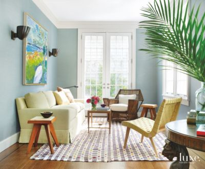 intimate, casual sitting room with patterned rug \u0026 midcentury modern