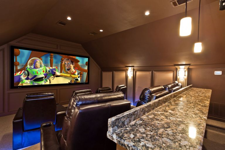 An extra bedroom becomes a state of the art cinema experience ...