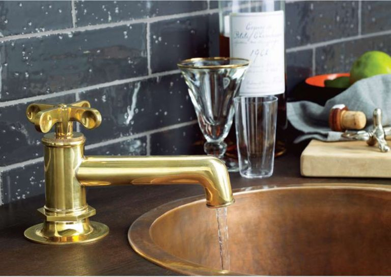 Waterworks bathroom faucet in gold finish over copper sink. - Luxe ...