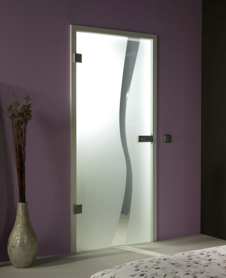 This Frameless Glass Door Has An Off Centered V Groove Design On