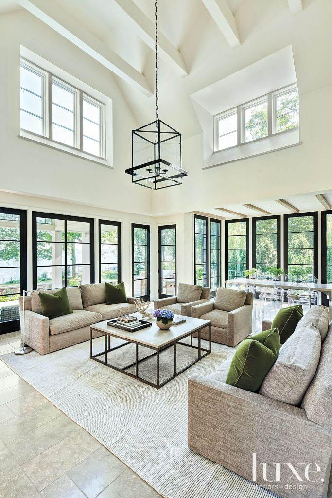 contemporary white family room with high ceiling luxe interiors