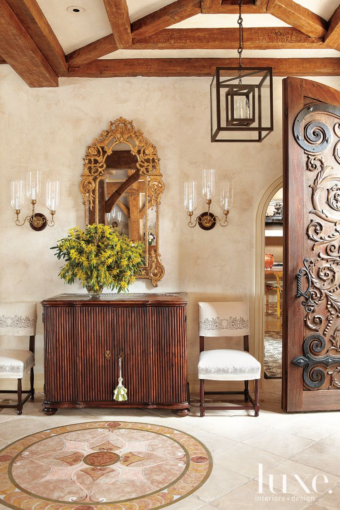 Mediterranean foyer with wooden console   luxe interiors   design