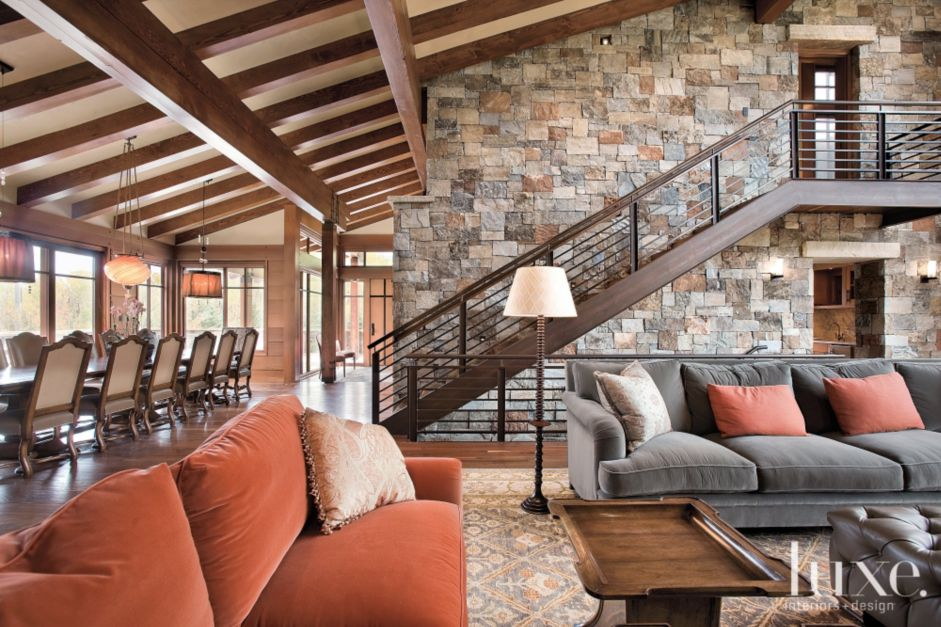 Living Room With Multihued Stone Wall Luxe Interiors