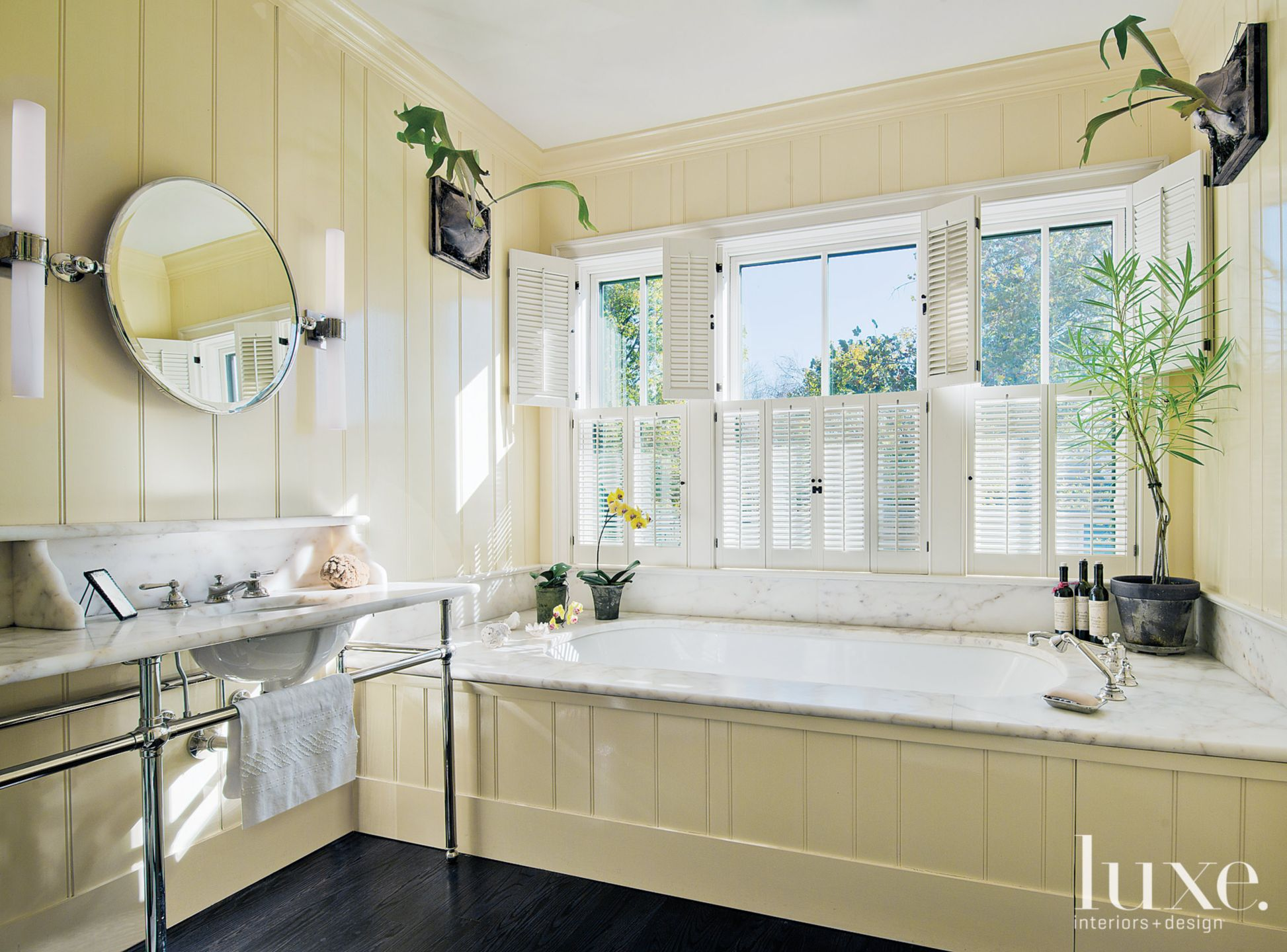 Traditional Yellow Master Bathroom with Marble Vanities