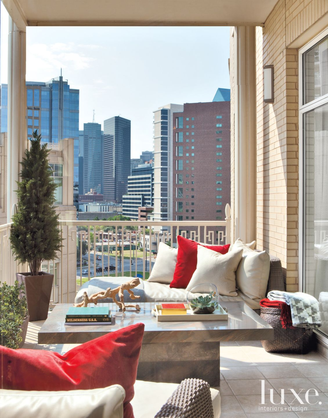 Modern Neutral Balcony with Red Accent Pillows