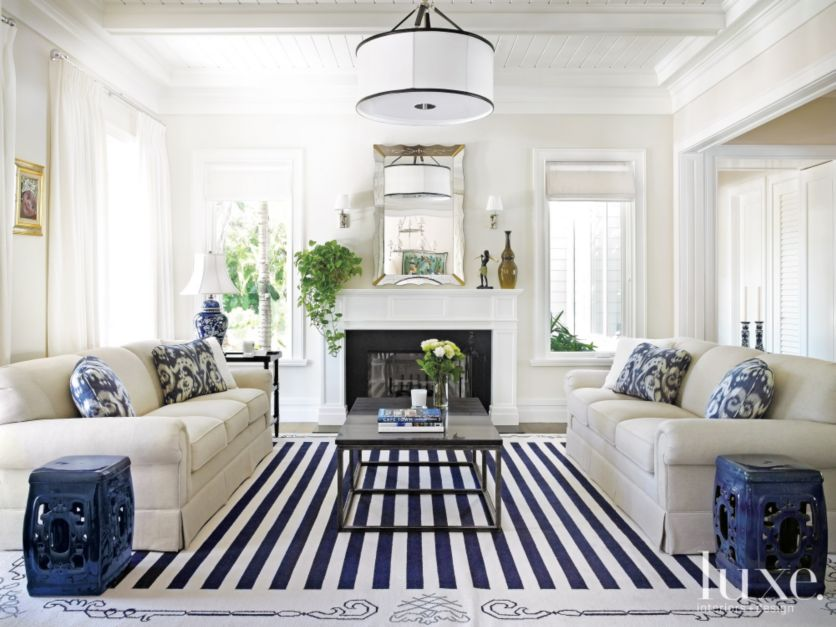 transitional white living room with dark blue accents - luxe