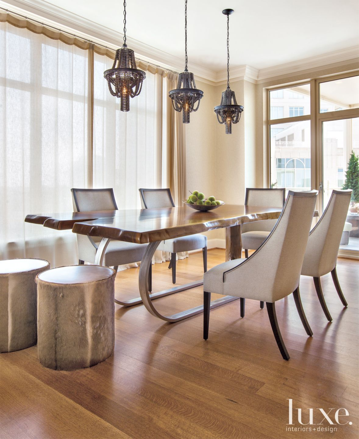 Modern Neutral Dining Room with Bicycle Part Pendants