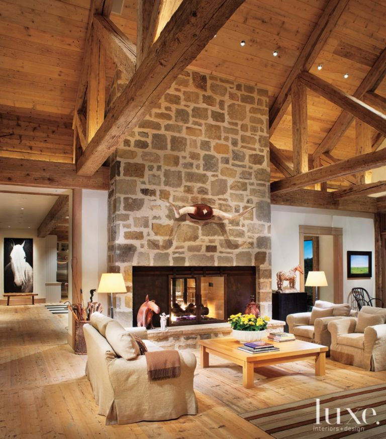 Rustic Wood Living Room With Pitched Ceiling
