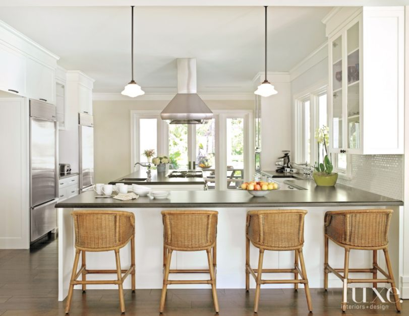 Transitional White Kitchen With Rattan Barstools Luxe