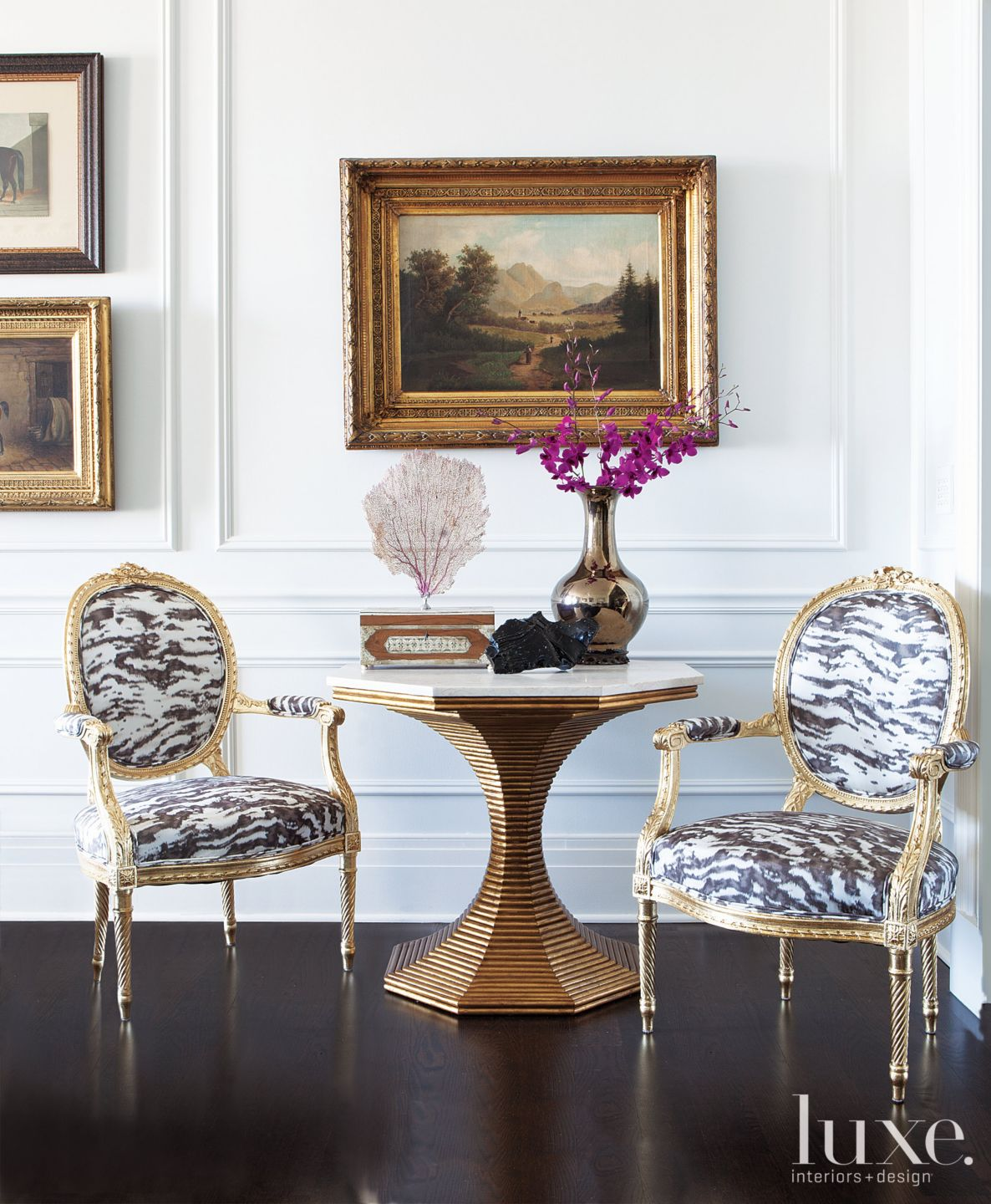 Eclectic White Sitting Area with Zebra-Print Chairs