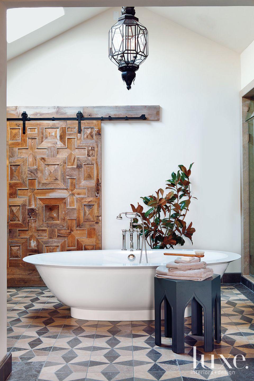 Mediterranean White Bathroom With Geometric Barn Door