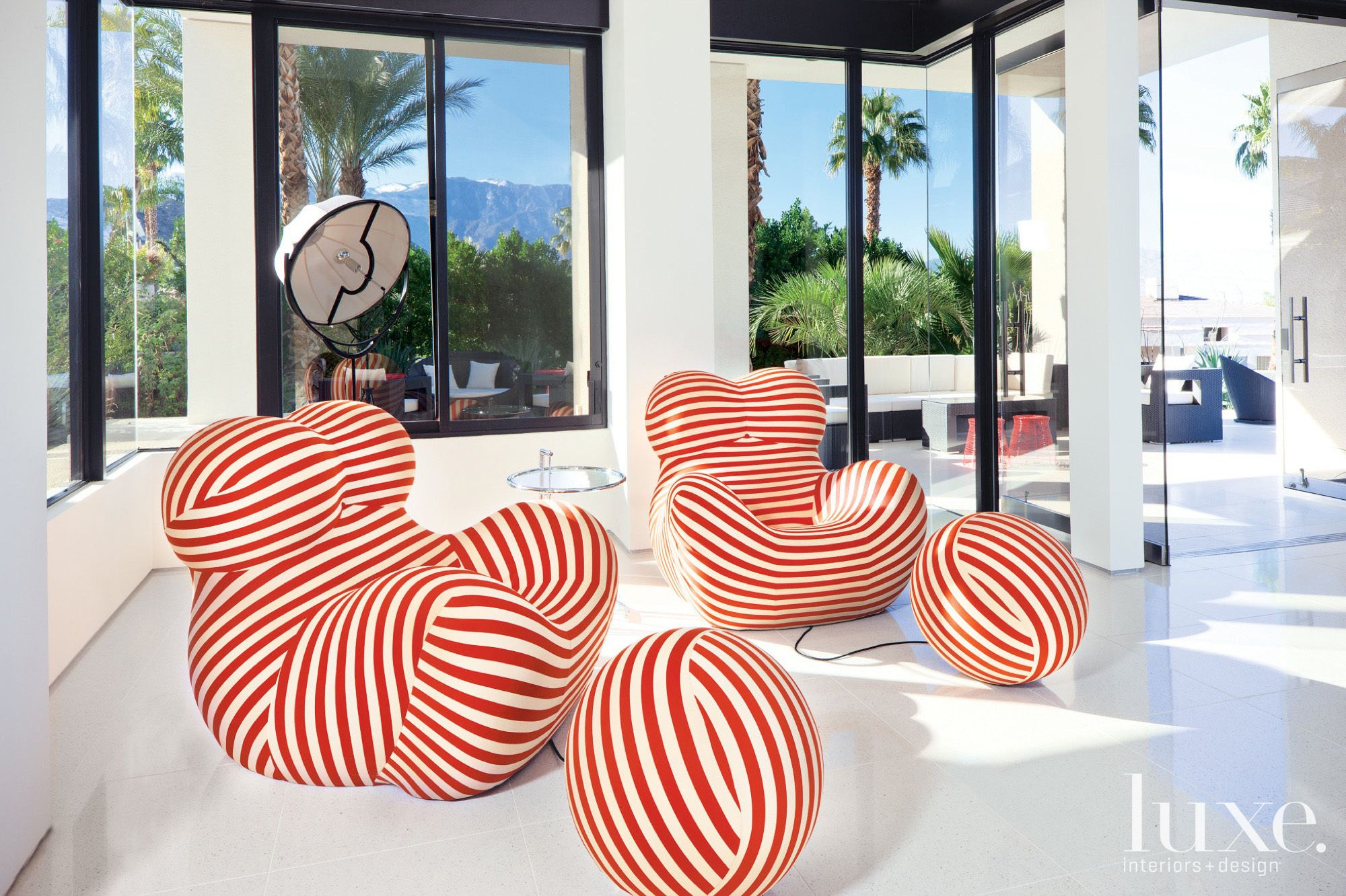 White Modern Sitting Area with Whimsical Red Striped Chairs
