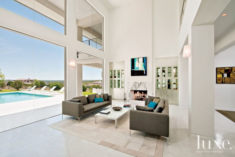 modern white double height living room luxe interiors design