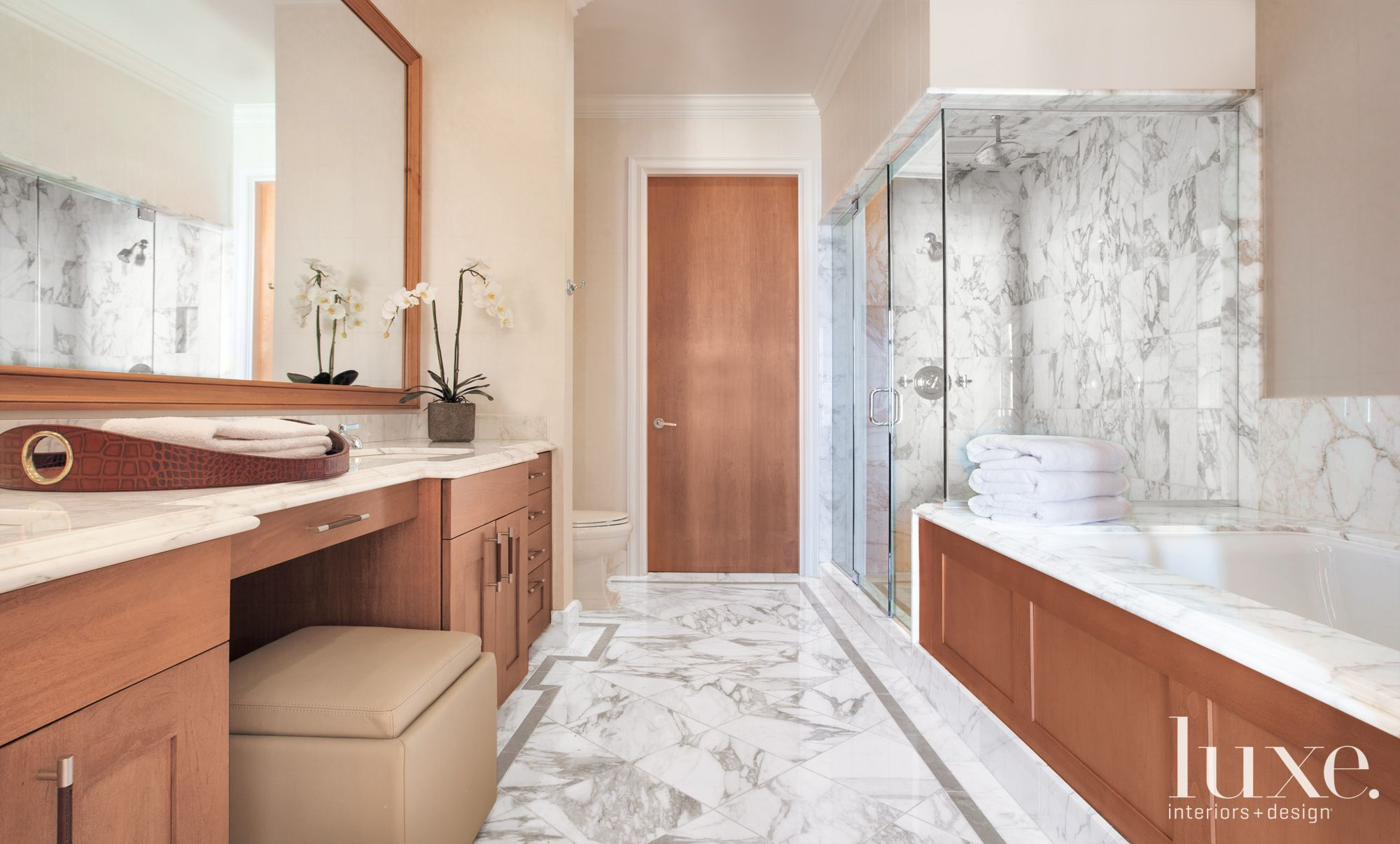 Modern Cream Master Bathroom with Calacatta Vagli Marble
