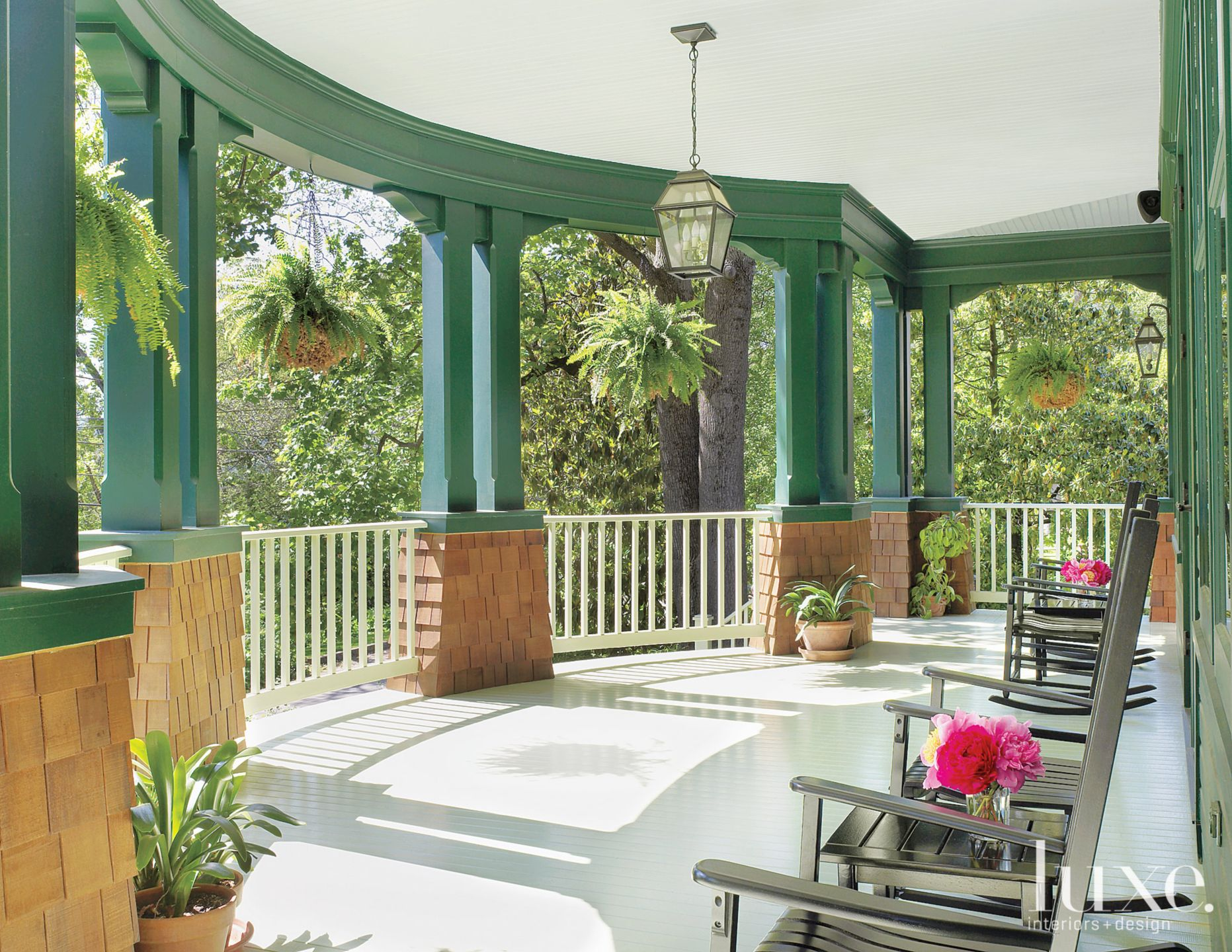 Country Green Back Porch with Rocking Chairs