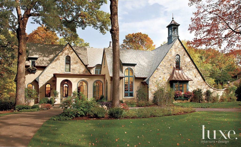 Transitional house with classic elements and a lighter for Olde world homes