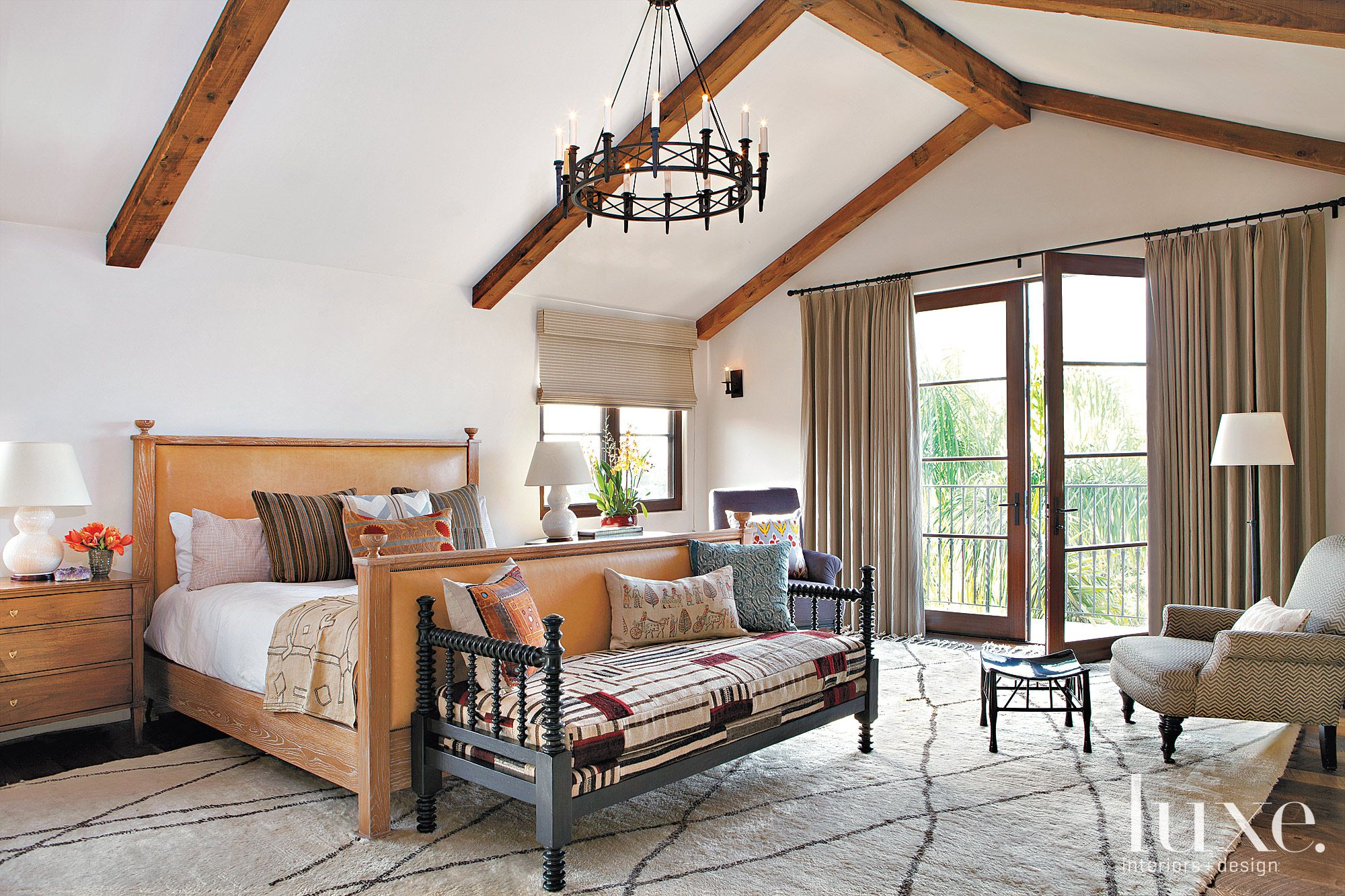 Mediterranean White Bedroom with Vaulted Ceiling