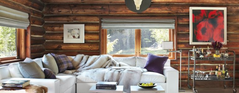 transitional woodstock log cabin with vibrant twist features