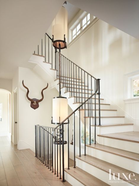 Contemporary White Stairway With Custom Light Fixture