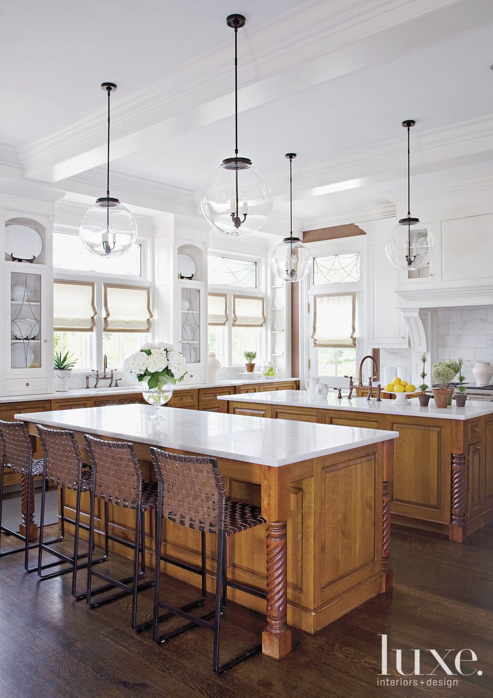 Traditional White Kitchen with Globe Pendants