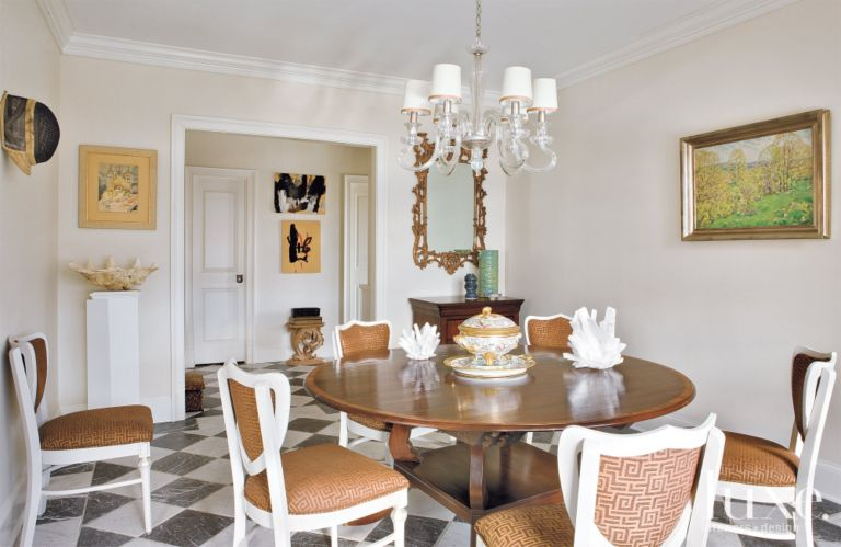 Eclectic White Dining Room With Sculptural Chandelier