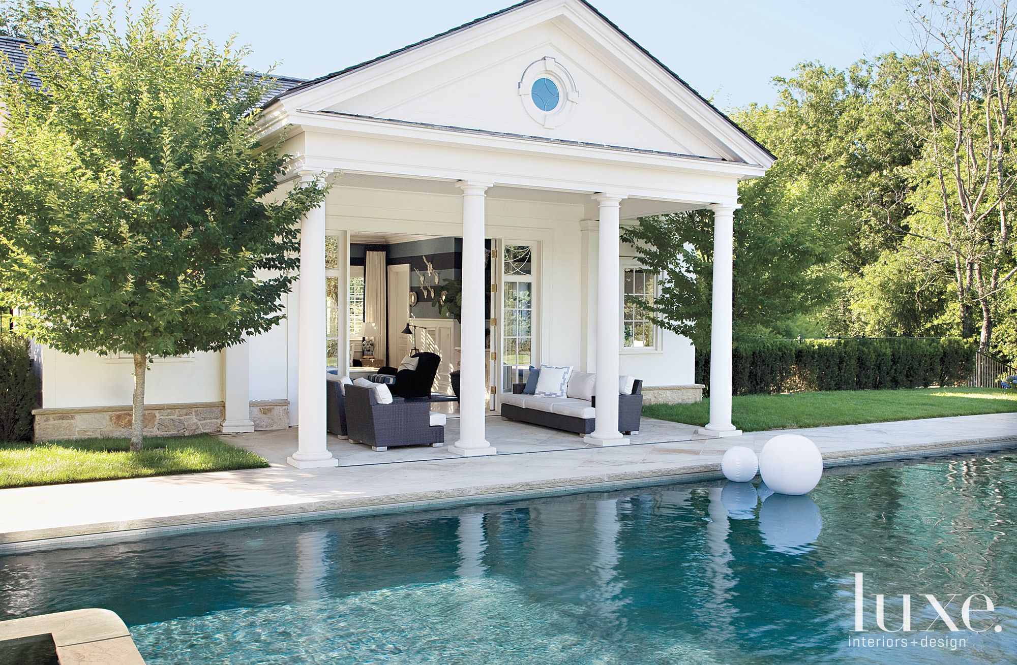 Traditional White Pool House with Columns