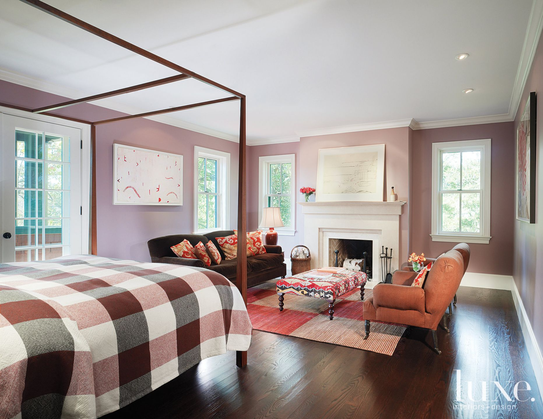 Country Purple Bedroom with Fireplace-side Seating Area