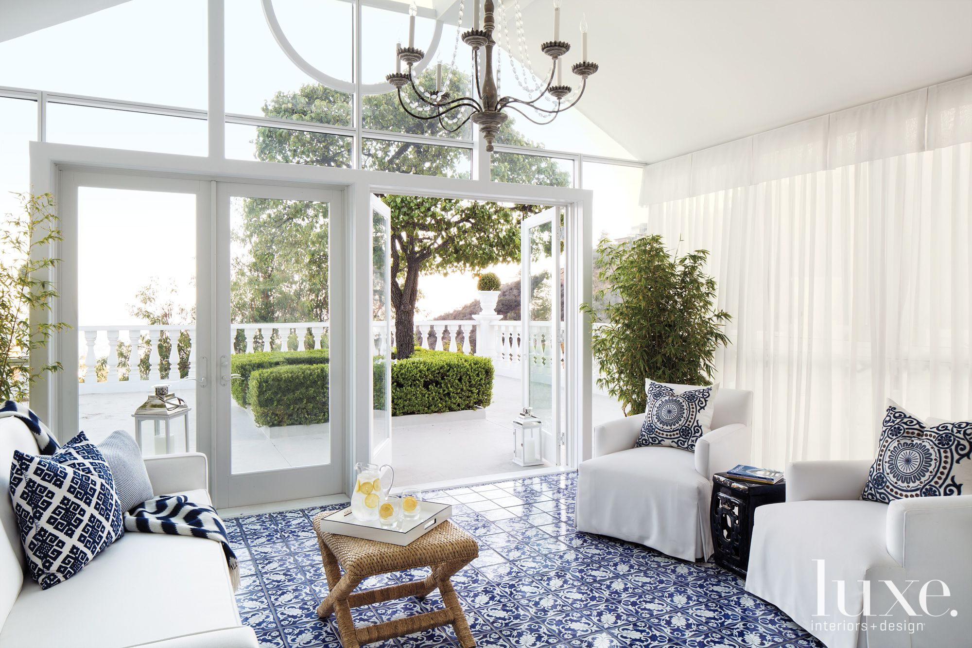 Modern Sunroom With Blue Tile Floors