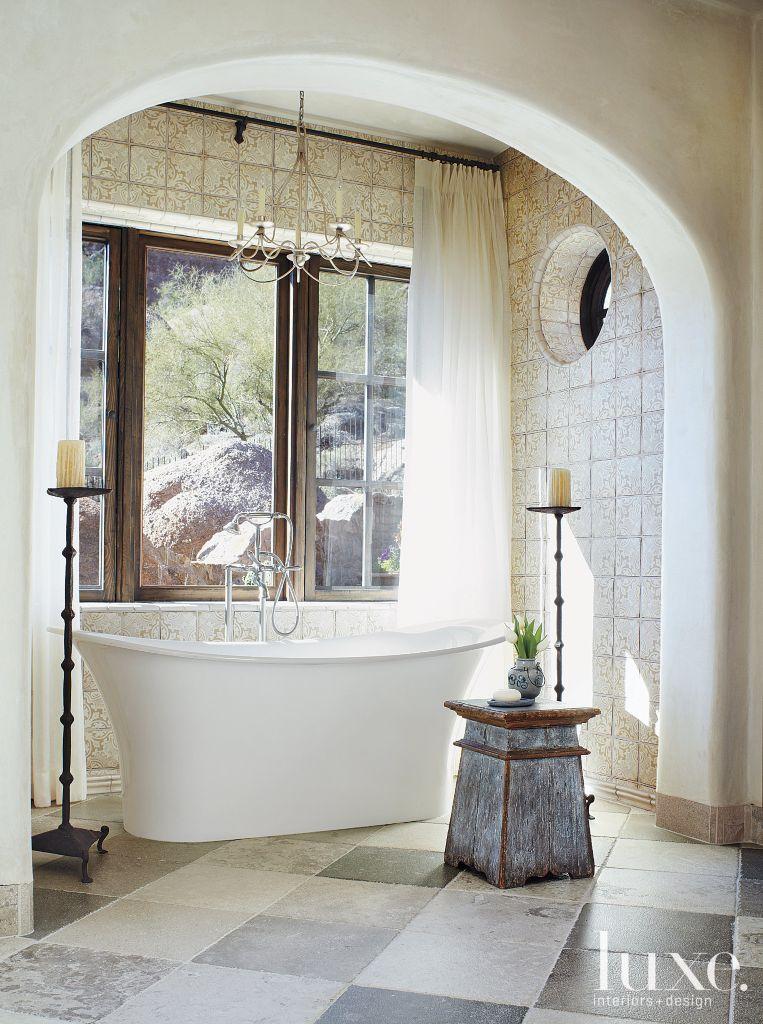 Cream Old World Bathroom With Freestanding Tub Luxe Interiors Design