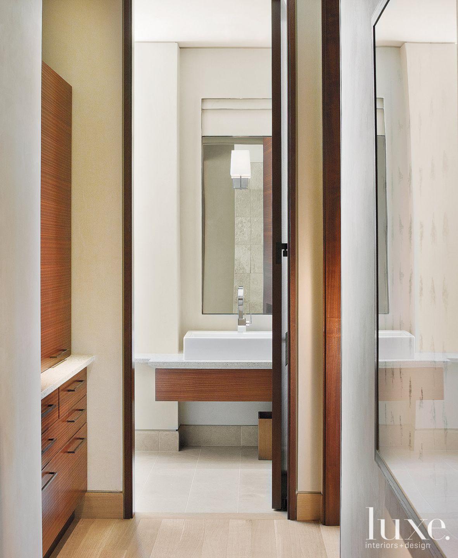 Modern White Powder Room with Sleek Millwork