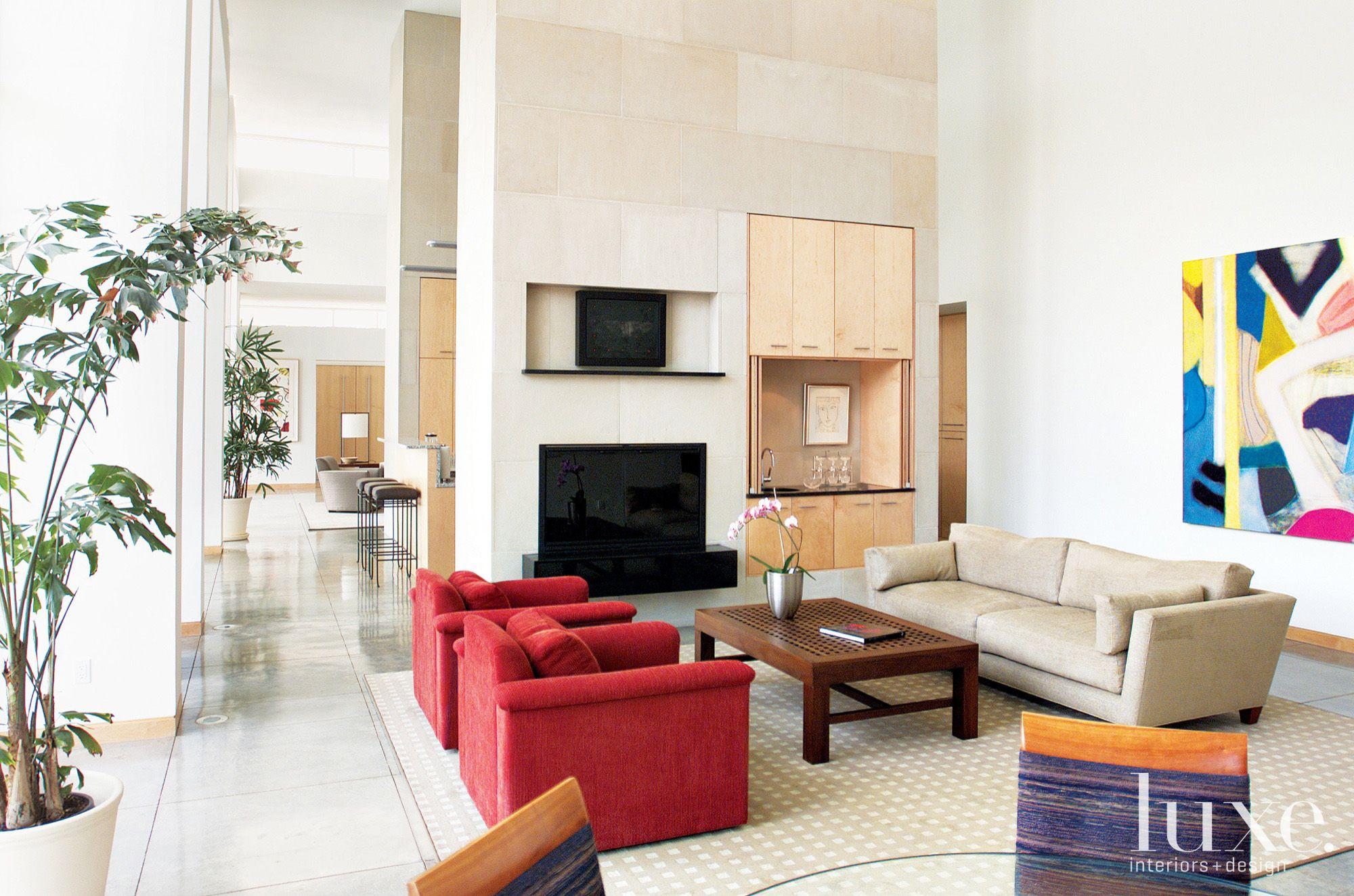Modern White Den with Limestone Fireplace Surround