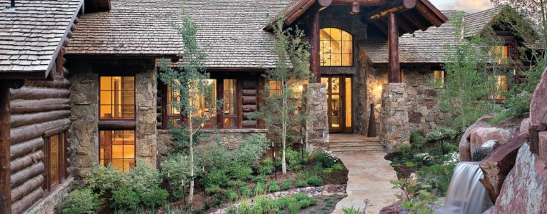 A Vail Cabin-Style Retreat with a Log and Rock Veneer Façade ...