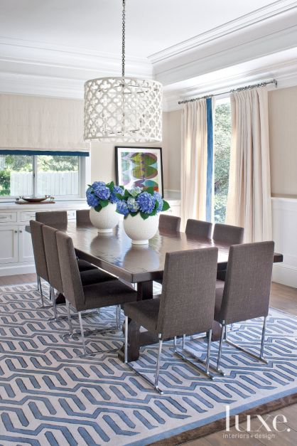 Contemporary White Dining Room With Blue Patterned Rug