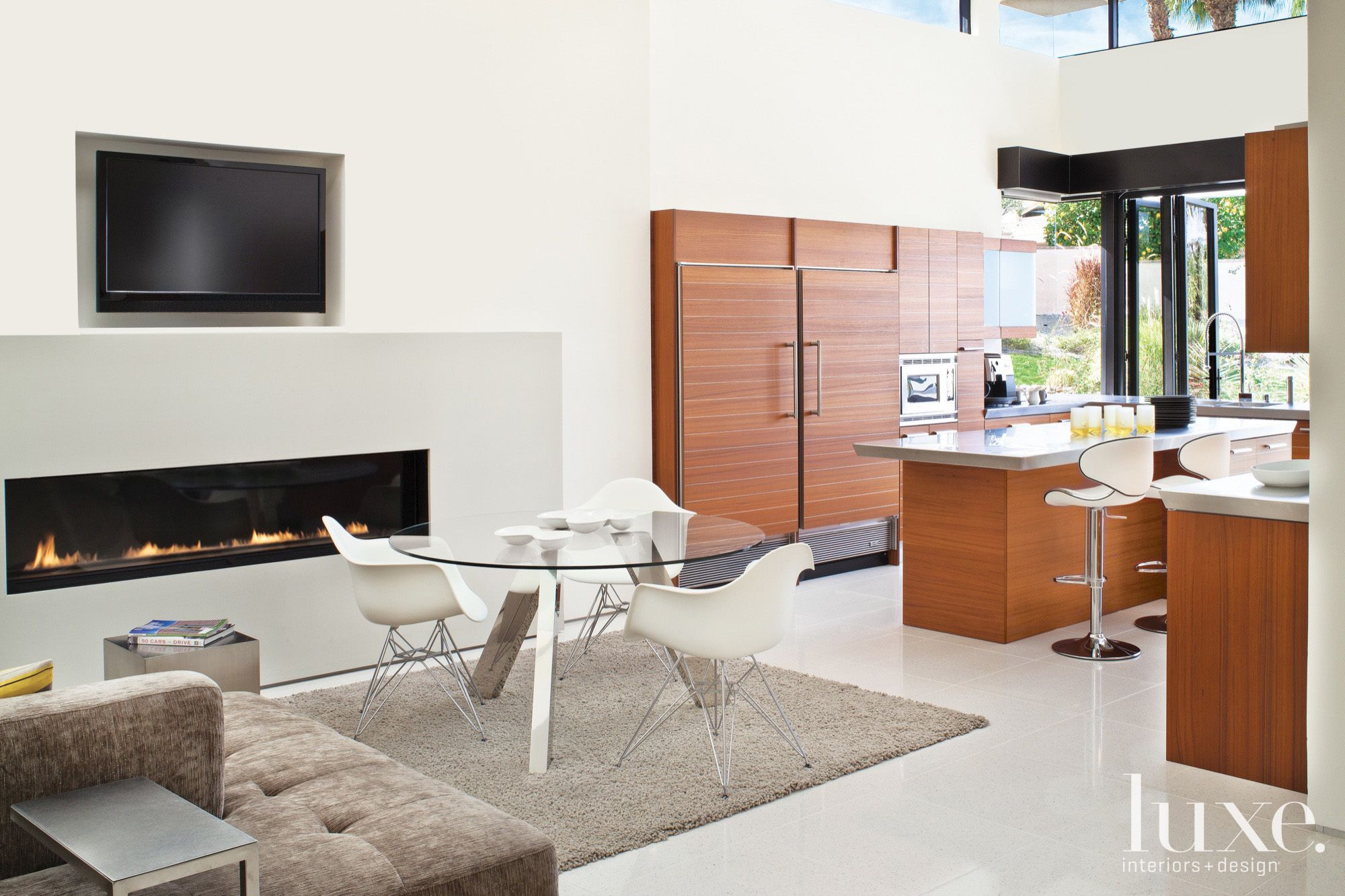 Contemporary White Sitting Area with Eames Chairs