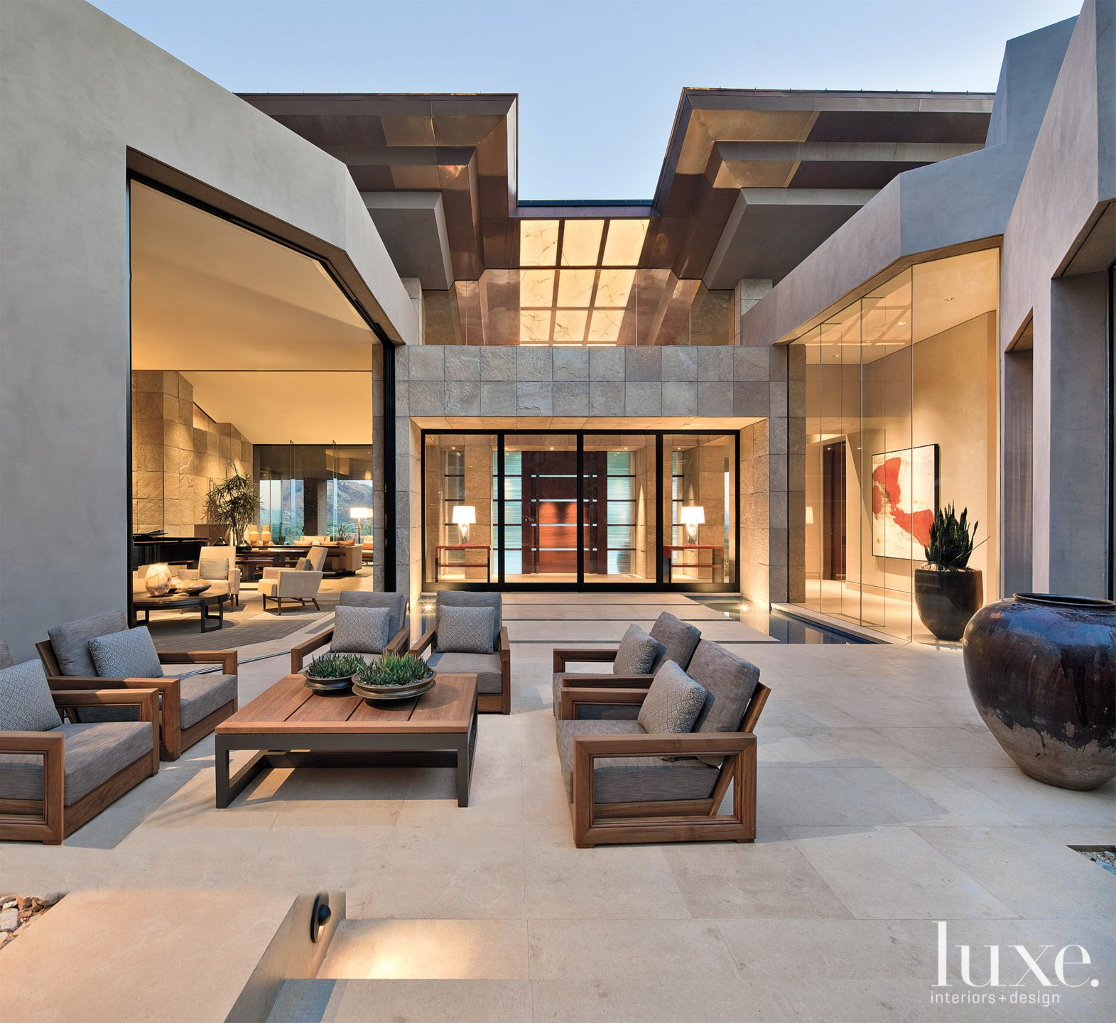 Modern Gray Courtyard with Sculptural Copper Roof