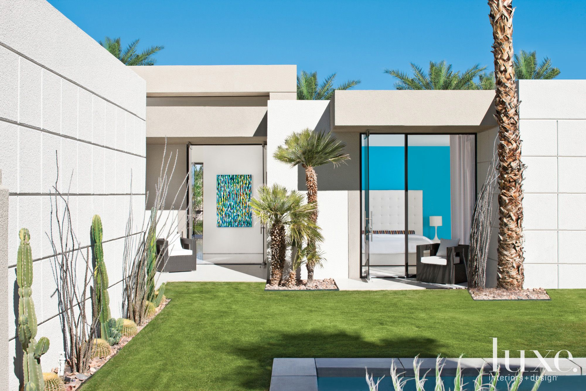 Contemporary White Exterior with Grassy Lawn