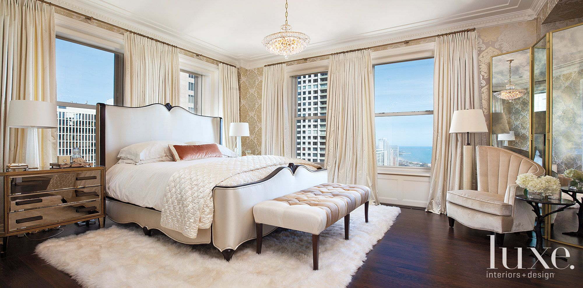 Eclectic White Bedroom with Crystal Chandelier