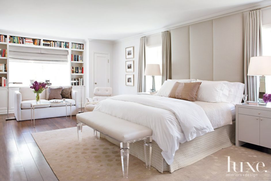 contemporary white bedroom with floortoceiling headboard
