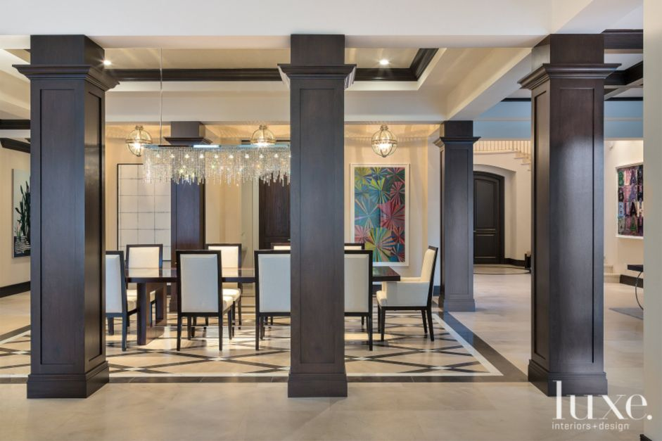 Dramatic Transitional Column Framed Open Dining Room