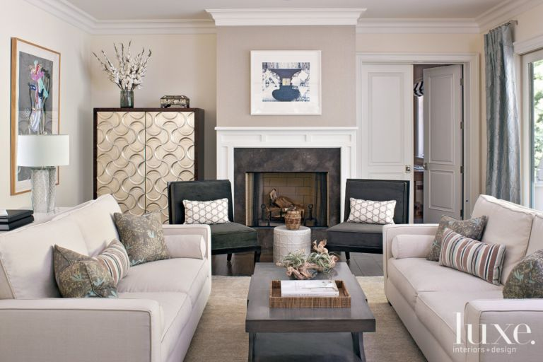 neutral contemporary living room with metallic cabinet - luxe