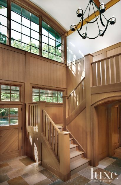 Traditional Brown Staircase With Light Filled Atrium