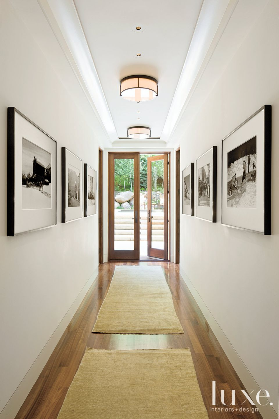 Contemporary White Hallway with Black-and-White Photos
