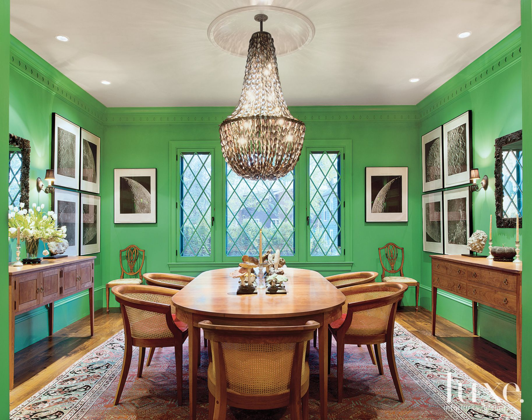 Eclectic Green Dining Room with Statement Chandelier
