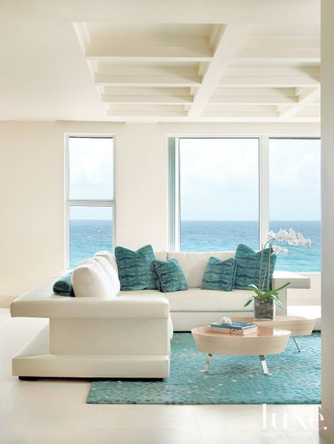 Light filled oceanside condo with sea inspired hues for Modern beach house furniture