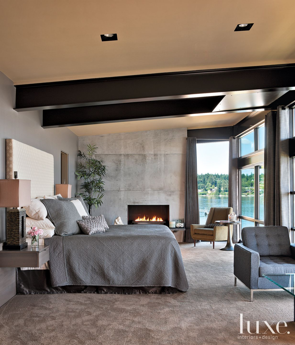 Modern Gray Master Bedroom with Concrete Fireplace