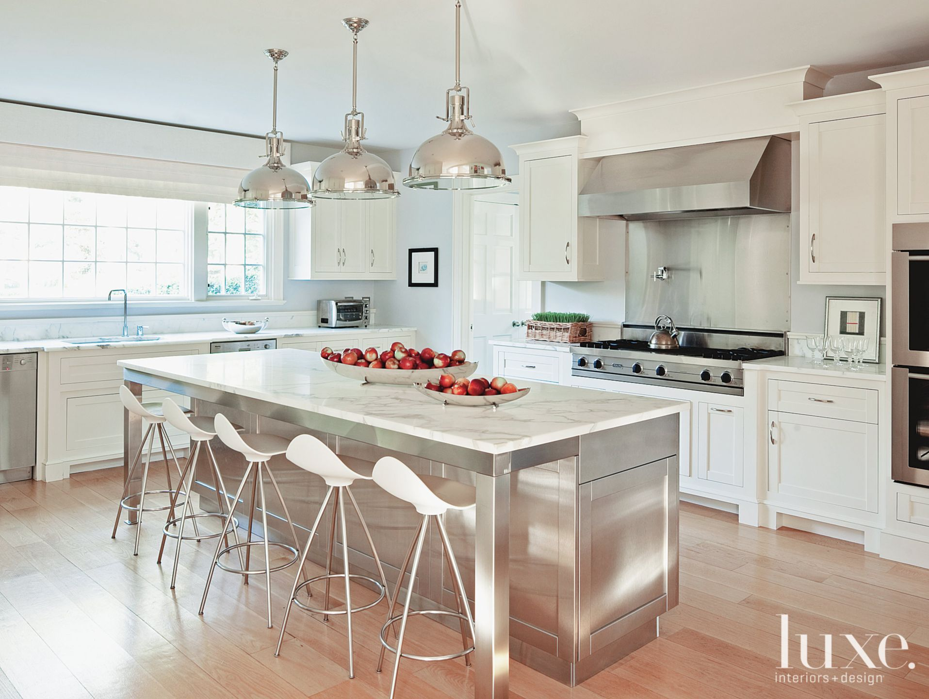 Transitional White Kitchen with Stainless-Steel Island